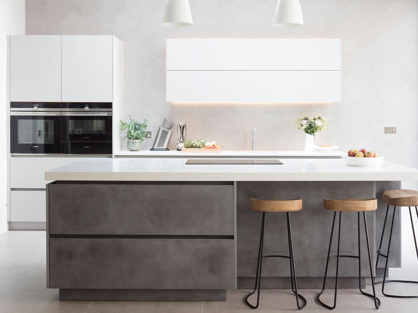 Luxury kitchen design with silver bespoke kitchen island in silver with white work surfaces