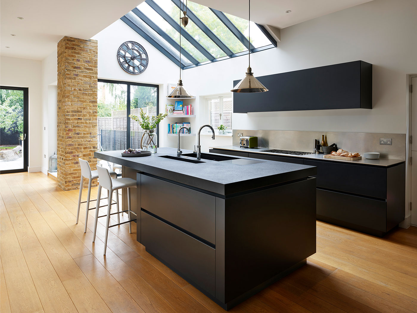 Contemporary kitchen design with bespoke kitchen island in black